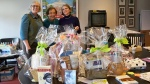 volunteers with pre-auction baskets for newton Free Library Spring Fling fundraiser